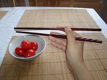 Mit Stäbchen essen - Schritt 3